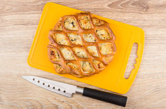 Pie filling on cutting board, kitchen knife on wooden table Royalty Free Stock Images