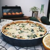 Pie with red fish and spinach royalty free stock photo