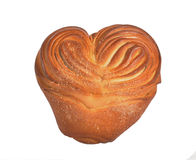 Pie in the form of heart. The large pie in the form of heart lays on a table Royalty Free Stock Image