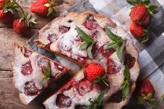 Pie with fresh strawberries and mint top view horizontal Stock Photos
