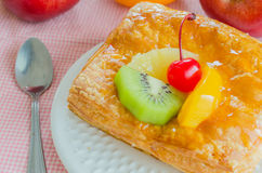 Pie. Fruit pie in white dish on the wood table Stock Photo