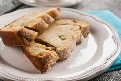 Pie fruitcake pear and a slice of a cup of tea Royalty Free Stock Photography