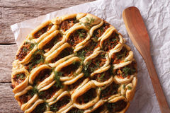 Pie with ground meat and vegetables closeup. Horizontal top view Stock Photos