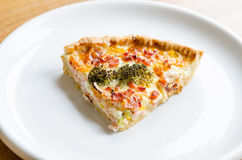 Pie slice on plate. Pie with ham and broccoli Royalty Free Stock Photo