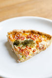 Pie slice on plate. Pie with ham and broccoli Royalty Free Stock Images