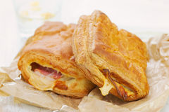 Pie with ham and cheese. With glass of water Royalty Free Stock Photo