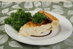 Pie with a hen. Decorated parsley Stock Photos