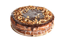 Pie house. The chocolate pie costs on a table Royalty Free Stock Image