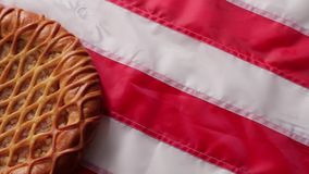 Pie laying on USA flag. American flag and round pie. Traditional bakery with fruits. Tastes like home stock video