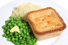 Pie & Mash. Individual steak pie with peas and mashed potato Stock Images