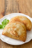 Pie with meat with basil on white plate Stock Images