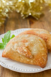 Pie with meat with basil on white plate Royalty Free Stock Photo