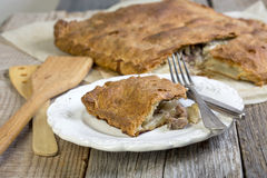 Pie with meat and potatoes on the plate. Royalty Free Stock Photo