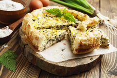 Pie with nettles and spring onion Stock Photo