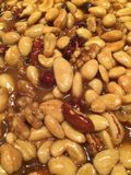 Pie with nuts. Pie with caramelized brown nuts Stock Images