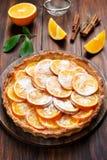 Pie with orange caramelized slices. Fruit pie with orange caramelized slices on wooden table royalty free stock image