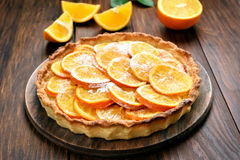 Pie with orange caramelized slices Royalty Free Stock Photo
