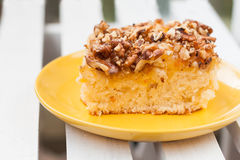 Pie with orange jam and walnuts on a wooden background.  Stock Image