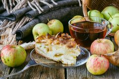 Pie with organic apples and hot brewed tea Royalty Free Stock Photo