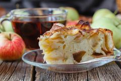 Pie with organic apples and hot brewed tea Stock Photography