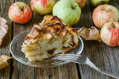 Pie with organic apples and hot brewed tea Stock Photos