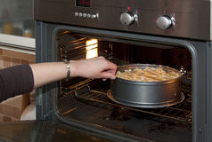 Pie in the oven Royalty Free Stock Photography
