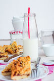Pie pastry with apple jam and milk in a glass bottle Stock Images
