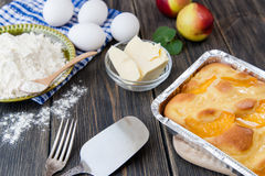 Pie with peaches. On an old wooden table with green leaves, rustic style Royalty Free Stock Photos