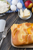 Pie with peaches. On an old wooden table with green leaves, rustic style Stock Photos