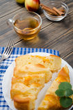 Pie with peaches. On an old wooden table with green leaves, rustic style Royalty Free Stock Image