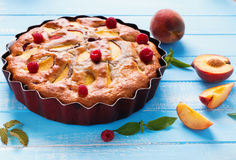 Pie with peaches and raspberry Royalty Free Stock Image