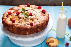 Pie with peaches and raspberry Royalty Free Stock Photography