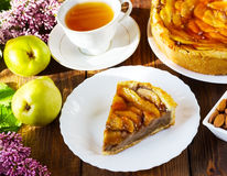Pie with pears on a white plate Stock Images