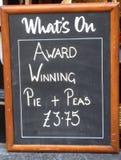 Pie and peas Stock Photos