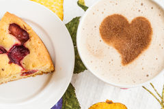 Pie with plums and a cup of coffee and heart Stock Photography