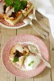 Pie with plums and peaches, served with a vanilla ice cream ball and lemon balm leaves. Stock Images