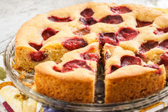 Pie with plums and slice and cup with coffee Stock Photography