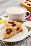 Pie with plums and slice and cup with coffee Royalty Free Stock Images
