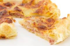 Pie with potatoes, ham and mozzarella Stock Photos