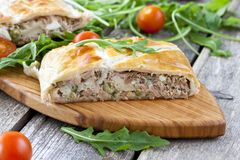 Pie of puff pastry with tuna, rice and egg. Pie of puff pastry with tuna, rice, egg and peas Royalty Free Stock Photo
