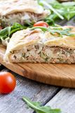 Pie of puff pastry with tuna, rice and egg. Pie of puff pastry with tuna, rice, egg and peas Stock Photo