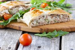 Pie of puff pastry with tuna, rice and egg. Pie of puff pastry with tuna, rice, egg and peas Stock Photos