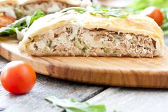 Pie of puff pastry with tuna, rice and egg. Pie of puff pastry with tuna, rice, egg and peas Stock Photography