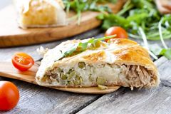 Pie of puff pastry with tuna, rice and egg. Pie of puff pastry with tuna, rice, egg and peas Royalty Free Stock Photography