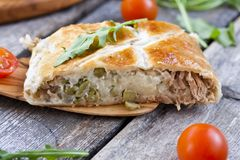 Pie of puff pastry with tuna, rice and egg Stock Images