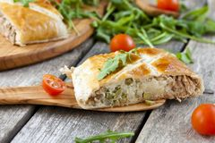 Pie of puff pastry with tuna, rice and egg. Pie of puff pastry with tuna, rice, egg and peas Stock Images