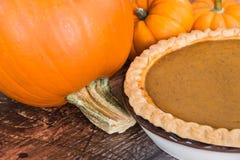 Pie pumpkin and a homemade pumpkin pie Stock Photos