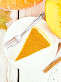 Pie pumpkin in plate on board top Stock Photography