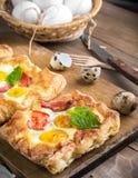 Pie of quail eggs with tomato Stock Image