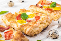 Pie of quail eggs with tomato Stock Images